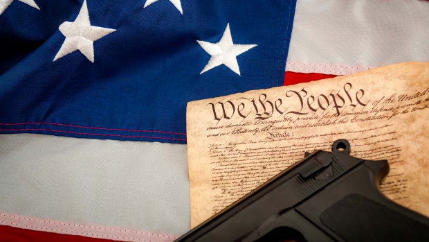 flag w gun & constitution iStock-539357008