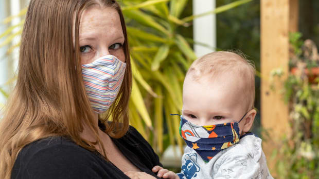 mother & baby w masks iStock-1215542440