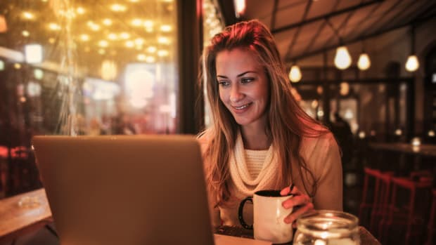 woman-sitting-by-the-table-using-silver-laptop-3783520