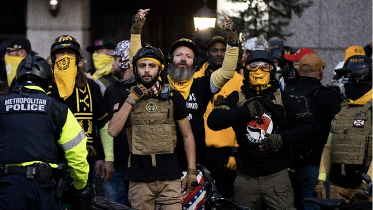 Remember 'Stand Down and Stand by'? Proud Boys Stab Four at Trump Rally