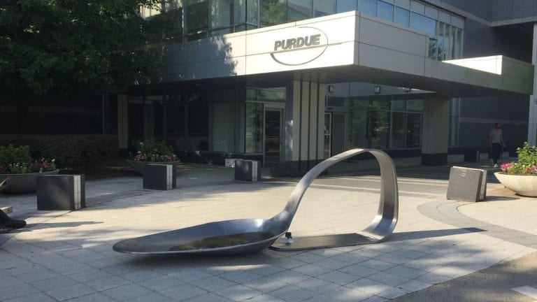 Gallery Owner Arrested For Placing 10 ft. Heroin Spoon Outside Oxycontin Maker