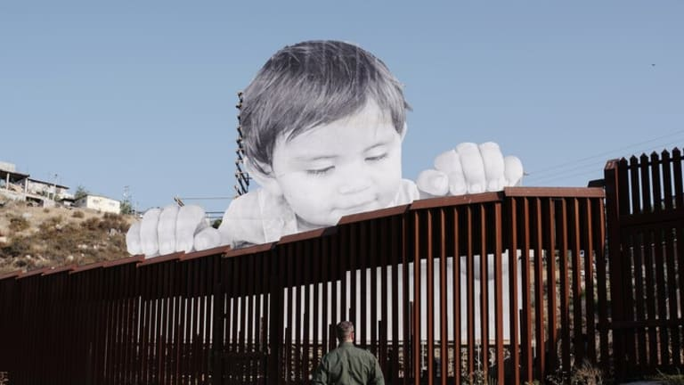 2017: Face of a Child Installed on Mexican Side of a Border Wall - Artist, JR