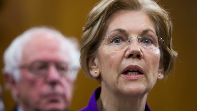 As Democrats Smooze Wall Street Donors, Warren and Sanders Refuse to