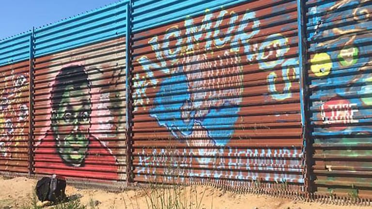 Artists turn U.S.-Mexico border fence into the world's longest peace-mural