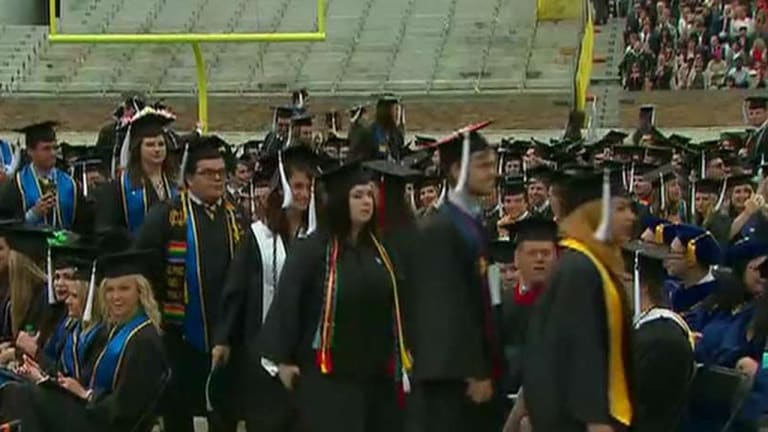 Dozens walk out before Mike Pence's commencement address at Taylor University