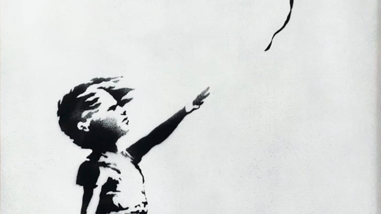 Banksy painting shreds itself moments after being sold for $1.4 million